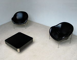2 black large lounge easy chairs 1970