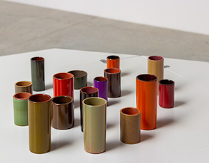 Collection of 16 ceramic cylinder vases 1960