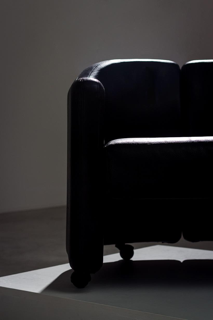 Eugenio Gerli two black leather lounge chairs Tecno Milano