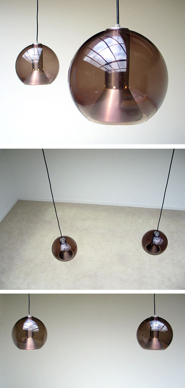 Pair of glass fume globes Raak lamps 1970 Large