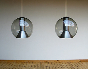 Pair of glass globe Raak lamps 1970