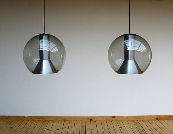 Pair of glass globe Raak lamps 1970