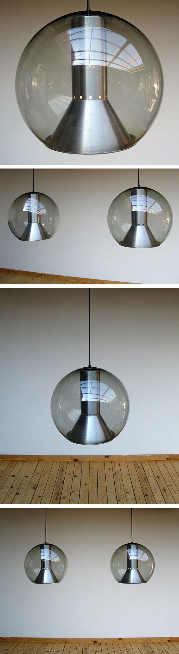 Pair of glass globe Raak lamps 1970 Large