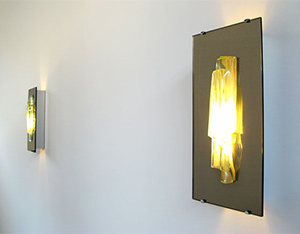 Pair of Raak mirror wall sconces