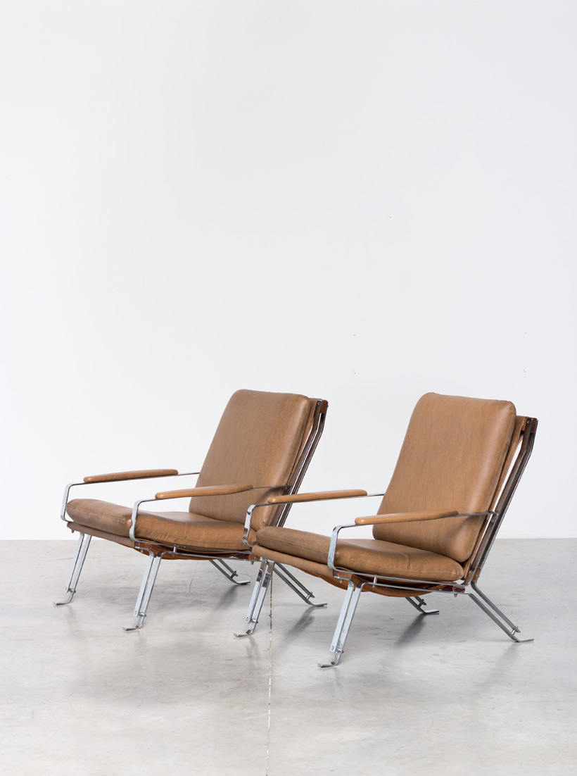 Pair sculptural chromed lounge chairs with armrests