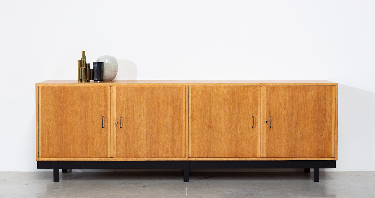 Fifties sideboard. Wooden oak structure raised on black wooden feet. Build on request circa 1950-1960.