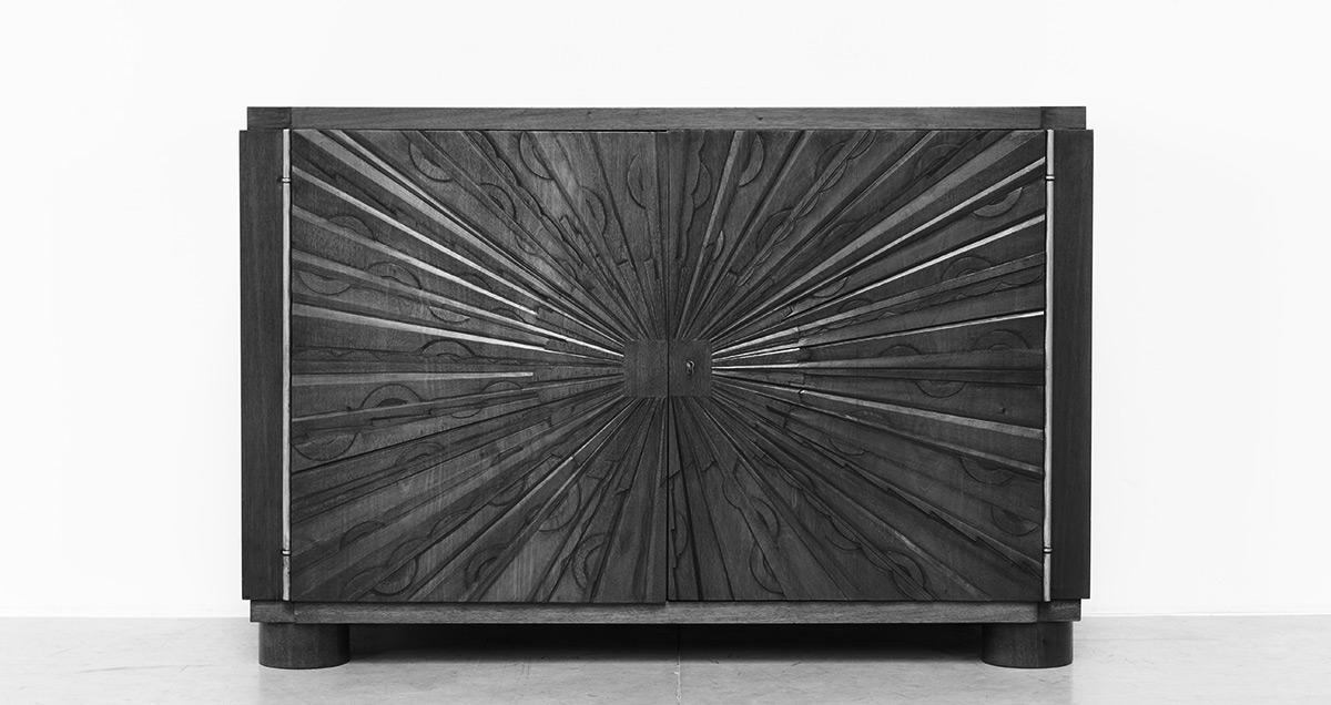 Graphic unique sideboard designed by cabinetmakers and decorators J. & E. Kint, Gand. Circa 1940, Belgium. Mahogany wooden structure. Sculptural graphical front doors. Raised on round legs. Signed with Kint & Fils Gand.