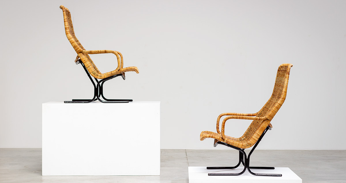 Pair lounge chairs model 514C. Designed by Dirk van Sliedregt for Gebr. Jonkers, 1966. The armchairs features a black steel tube frame with rattan seat. Dirk van Sliedregt designed numerous interiors and furniture, both for private houses and shops.