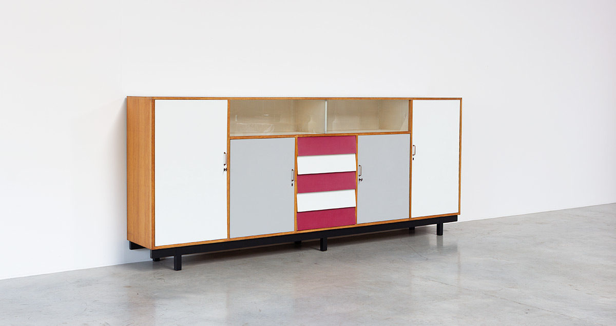 Colorful Formica XXL sideboard. Build on request circa 1950-60. With a play of colors laminated formica doors and drawers, red, white and industrial grey.