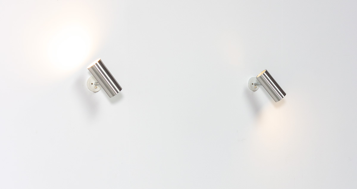 Pair of brushed metal cylinder spots, circa 1970. Brushed metal tube on a chrome stem that can be adjusted in any position.