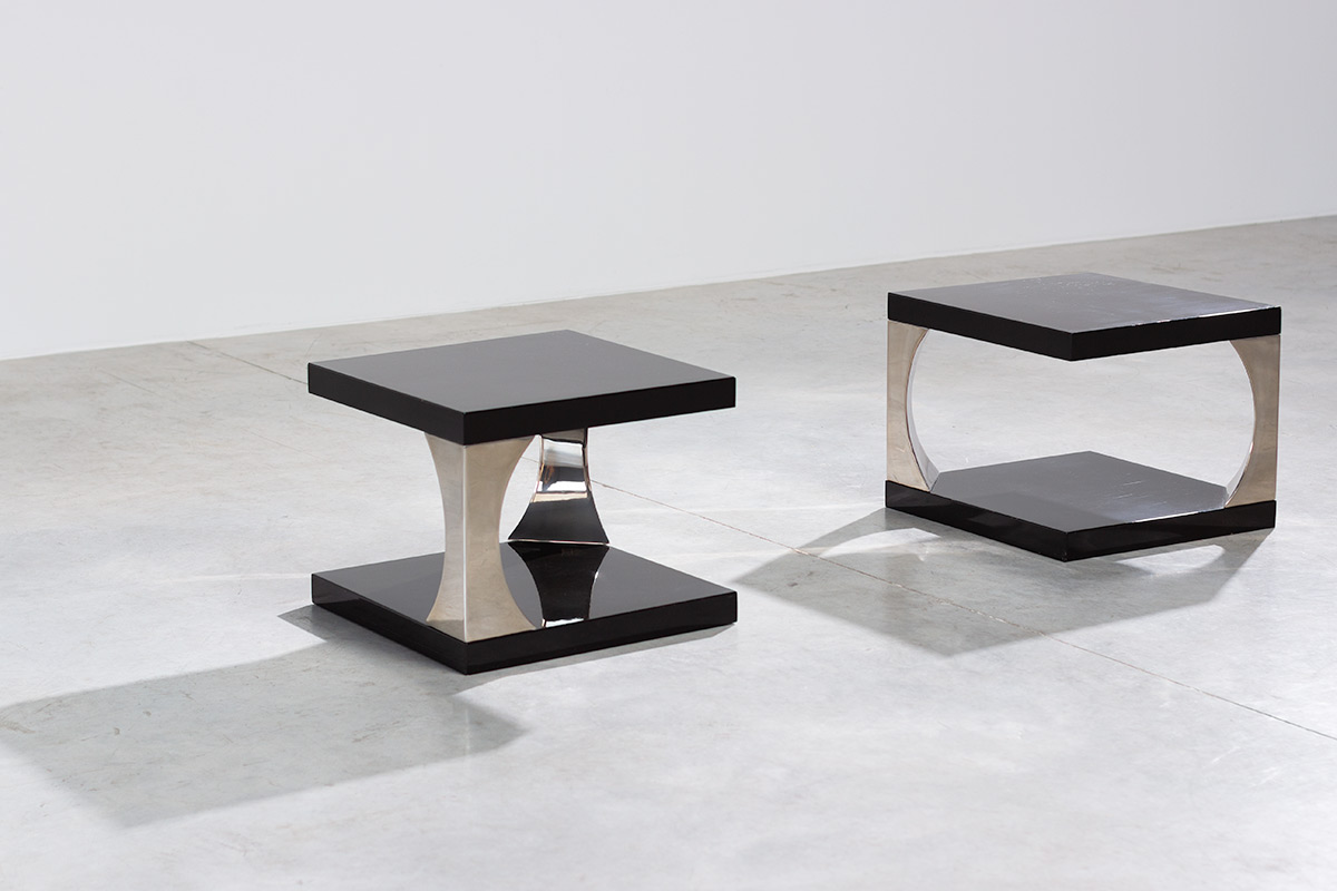 Pair elegant modern side tables. Italy circa 1970. Two-tier tables with dark brown lacquered wood and chrome supports.